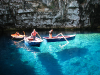 20 June 2010 - Boats bob in the waters of Melissani Lake, Kefalonia, Greece