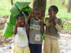18 April 2010 - Kids under a banana leaf umbrella in Uganda