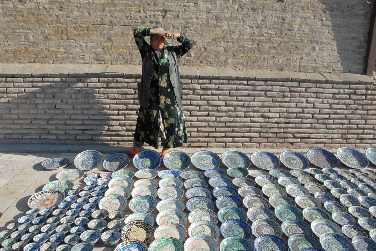 This woman is selling ceramic plates by the walls of Ichan-Kala in Khiva. Everything here is made by a master craftsman.