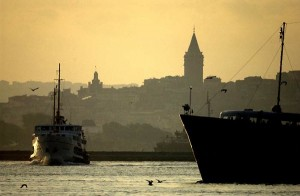 Istanbul's famous wooden municipal ferries ply the waters of the Bosphorus in the shadow of the city's ancient Galata Tower