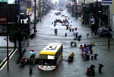 Residents of Manila do their best to come to grips with life in a city left flooded by Typhoon Ketsana