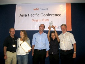 Teamworkz Consulting accepting its accolades as Franchisee of the Year 2008-2009 at the whl.travel Asia Pacific regional conference. Left to right are: Rob Shortland, whl.travel Asia Pacific Regional Director); Anne Done, Lee Sheridan and Mouk of Teamworkz; Len Cordiner, CEO of WHL Group
