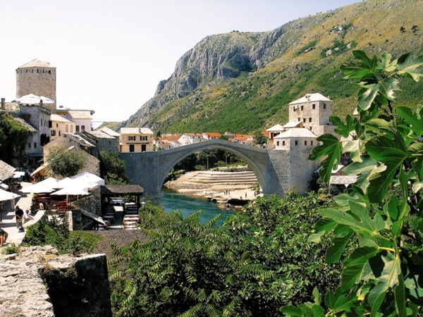 The Stari Most (Old Bridge) of Mostar, Bosnia-Herzegovina, spans the Neretva River. Originally built during the Ottoman era, it was destroyed during the Bosnian-Herzegovian War and then rebuilt according to the old design and using as much of the recovered original stone as possible. The bridge and surrounding historic neighbourhoods are now a World Heritage Site.