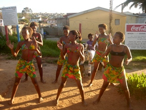 Traditional Xhosa dancers in South Africa perform for guests at a Mossel Bay township's first non-alcoholic shabeen