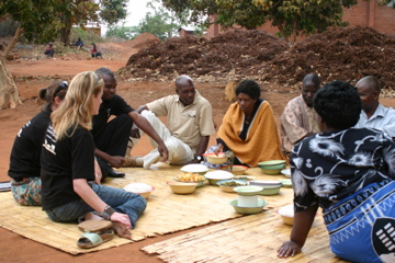Visitors having lunch with a Millennium Villages Project family in Mwandama, Malawi