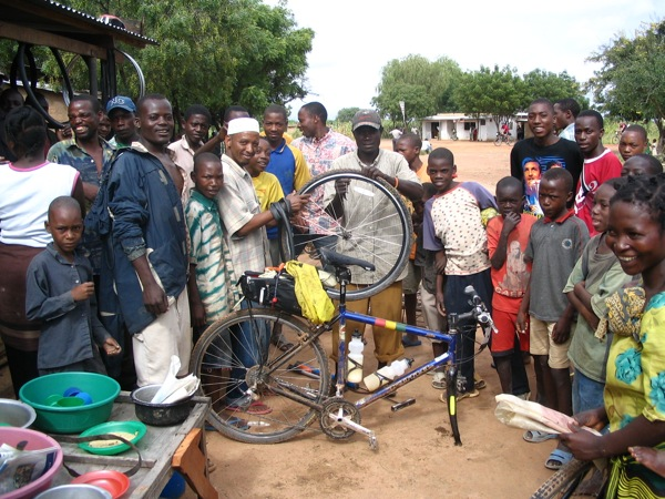 A local bike shop in Tanzania helps a Tour d'Afrique rider with some repairs (photo by Brian Hoeniger)