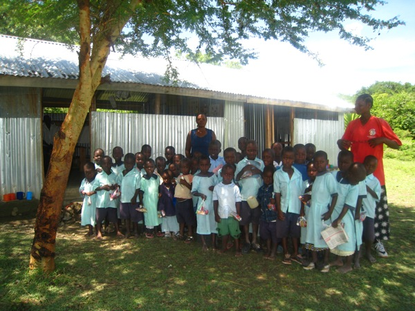 The orphanage run by Mr. Odula on Rusinga Island, Kenya, has a school with two classes of around 30 children in total. Here you can see one of the classes with the school's two teachers.