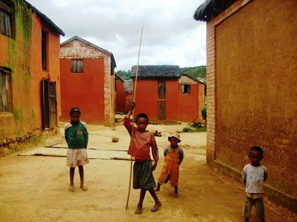 Children playing in the streets of Antsahabe village in the Sokafana district. Fanamby, along with the neighbouring Saha Forest Camp, assist in the development of local communities like Antsahabe and provide conservation education for village children in Madagascar.