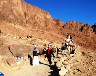 Trekkers descend from the peak of Mount Sinai (Mount Horeb), Egypt, after watching the legendary sunrise visible from its peak