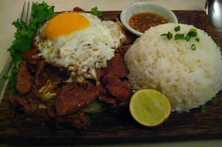 Beef Lok Lak is thinly sliced barbecued beef with pepper sauce, sometimes served with a fried egg on top