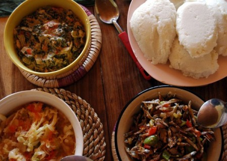 Nsima, Malawi's staple food, is prepared by cooking a mixture of maize flour and water until it becomes thick like mashed potatoes