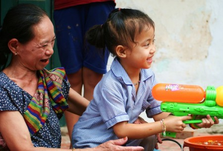 Woman and child enjoying Pi Mai Lao water fights in Laos