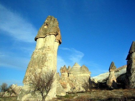 Volcanic rock formations like these fairy chimneys are scattered throughout the landscape of Cappadocia, Turkey