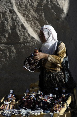 A woman from Soganli village displays her handmade doll to visitors in Cappadocia, Turkey