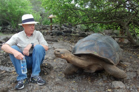 Giant tortoise with author's husband, Norm