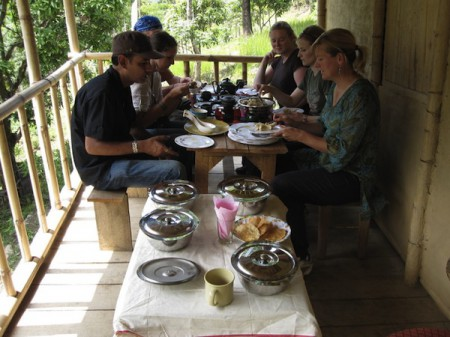 Foreign visitors enjoy a local meal in Mineral Spring