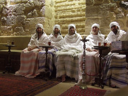 Five men cool down after a hammam in Damascus, Syria