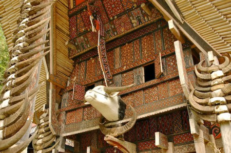 This closeup of the facade of a Tongkonan House shows some of the characteristic items, each of which is important in the Toraja culture of Sulawesi, Indonesia