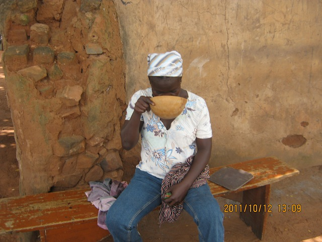 A local enjoys pito (beer) in northern Ghana