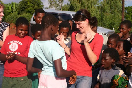 A visitor in Malawi dancing with kids