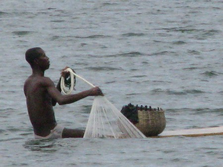 Ghana World Heritage Bosomtwe fisherman 450x337 World Heritage Sites of Ghana: Castles, Ashanti Houses and a Troubled Lake