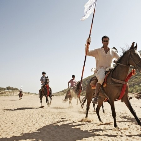 Humanitarian horseback rider in the desert