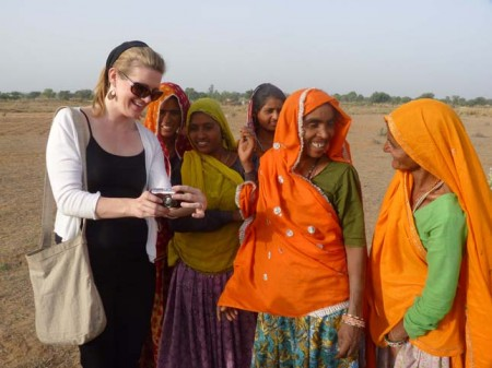 Tourist showing Indian women pictures of themselves