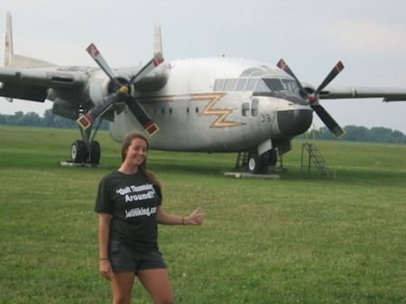 Nolan poses in front of a WW2-era plane parked in the small airport in Geneseo, NY. Photo courtesy of Amber Nolan