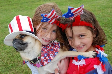 girls and a dog on the Fourth of July in the USA
