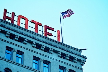 Hotel sign and American flag