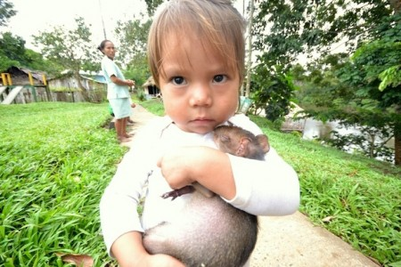 Child with an animal in San Juan de Soco, Colombia