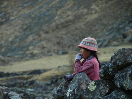 A girl in the mountains above Lares, Peru