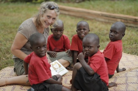 A volunteer works with children from the Kyabirwa Pre School in Jinja, Uganda