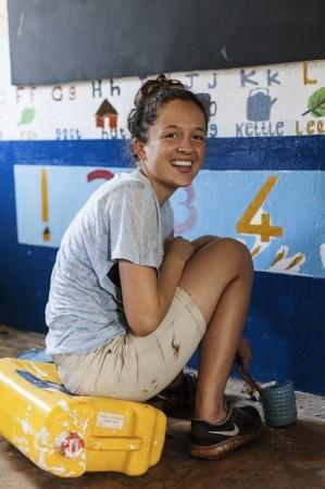 A volunteer paints in the new special-needs classroom in the Kyabirwa Pre School in Jinja, Uganda