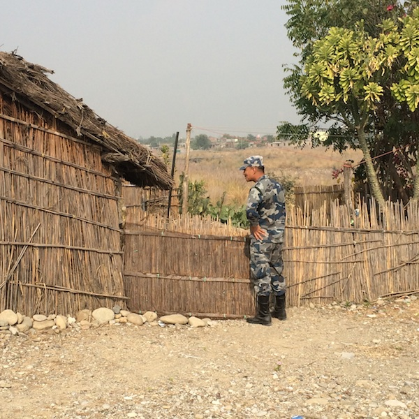 Nepali soldier working with Maiti Nepal speaks with local villagers about the dangers of human trafficking