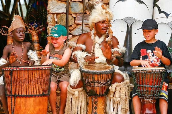Kids drumming with locals in South Africa