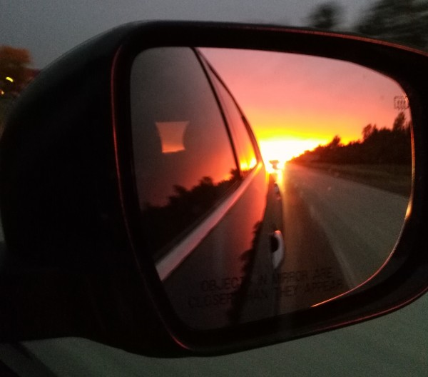 Sunrise in rearview mirror