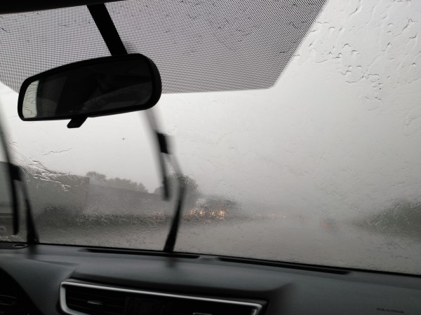 Driving in an afternoon torrential rain storm