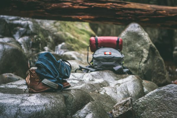 steps to more sustainable travel: go backpacking (backpacks on the ground)