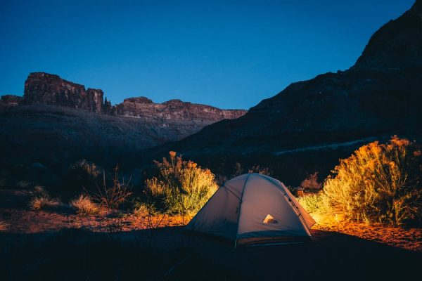 steps to more sustainable travel: tent at night