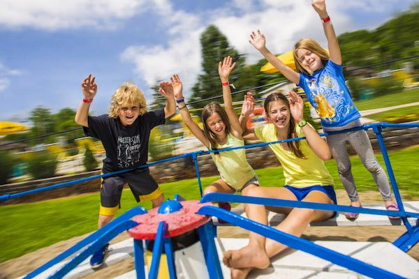family travel and camping - Kids at a KOA playground
