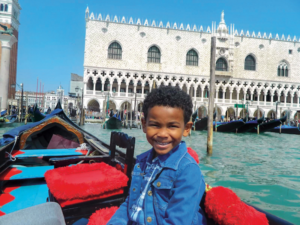 Boy on a shore excursion in Venice