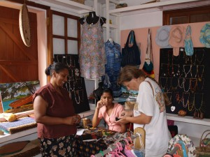 Nella surrounded by the crafts in her shop