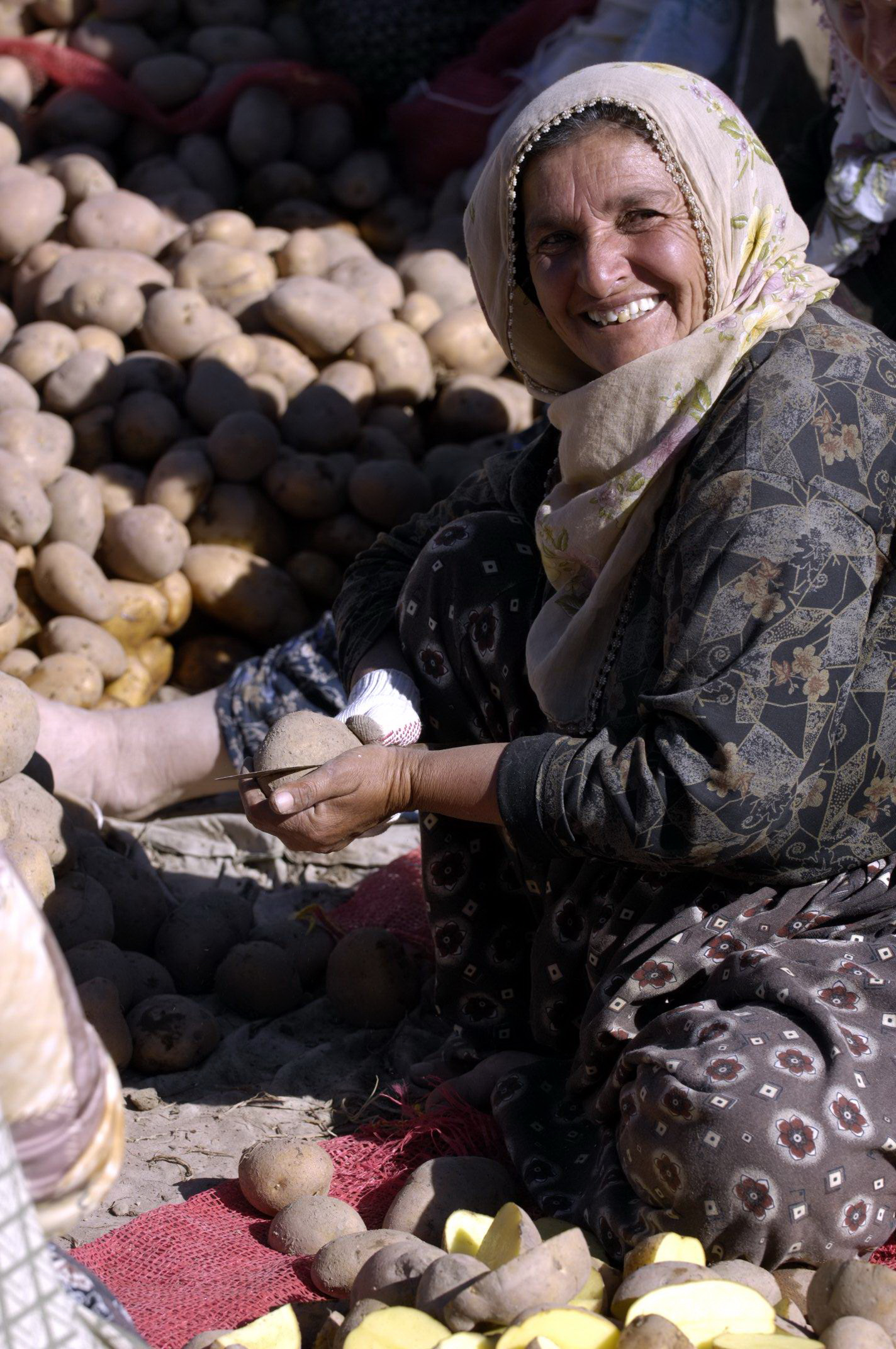 These women are from the villages of southern Cappadocia. The people of Cappadocia still store potatoes in caves. Before selling them, they must sort the good from the bad, the latter being cut into pieces and to animals.