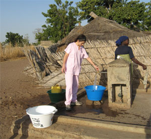Getting water is a fundamental part of village life and part of ths sustainable tourism experience in Senegal