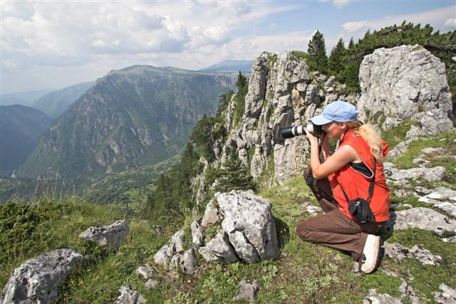 A hiker enjoying a photographic view on Durmitor Mountain