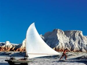 A traditional Jangada fishing raft with the area's beautiful white cliffs of in the background