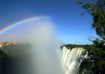 The spectacular 'Lunar Rainbow' cuts through the mist given off by Victoria Falls, Zimbabwe