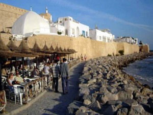 Customers enjoy a quiet drink in the famous Cafe Bouhdid, just outside Hammamet's ancient walls