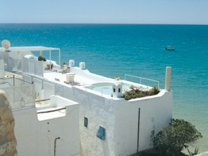 Houses in the Medina, or old city, look out over the tranquil, azure waters of the Gulf of Hammamet